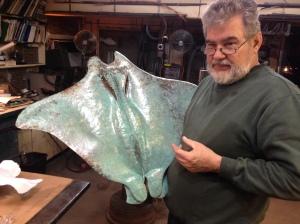 Metal artist John Barber displays his stingray
